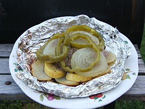 cooked hamburger in foil
